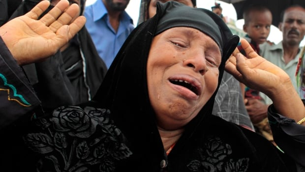Bangladesh's garment industry has come under international scrutiny after a factory collapse killed 1,100 people in April. Here, a Bangladeshi woman mourns her missing relative on July 24, the three-month anniversary of the Rana Plaza building collapse near Dhaka.