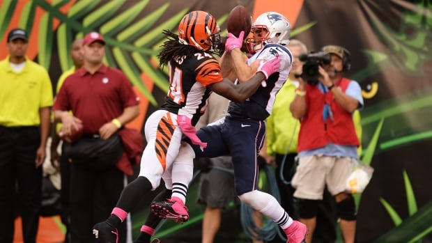 Cincinnati Bengals cornerback Adam 'Pacman' Jones, left, defends as Julian Edelman of the New England Patriots bobbles a pass in the end zone in the fourth quarter at Paul Brown Stadium on Sunday. Jones was found not guilty of allegedly assaulting a woman on Tuesday.