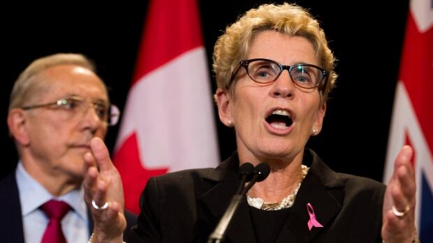 Ontario Premier Kathleen Wynne speaks to the media regarding the cancellation of two southern Ontario gas plants which is estimated to cost roughly $1 billion at Queen's Park in Toronto on Tuesday, Oct. 8, 2013.