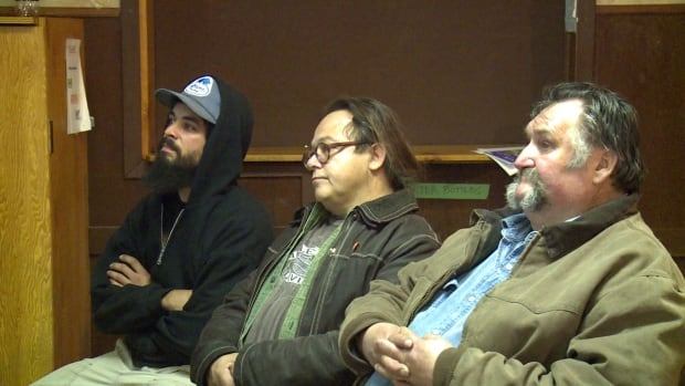 Residents including Mount Lorne-Southern Lakes MLA Kevin Barr (centre) listen during a public presentation in Carcross, Yukon, about a proposed campground at Atlin Lake on Oct. 8.