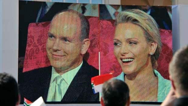 Charlene Wittstock and Prince Albert II of Monaco appear on a giant screen outside the Monaco palace during their civil wedding marriage ceremony.