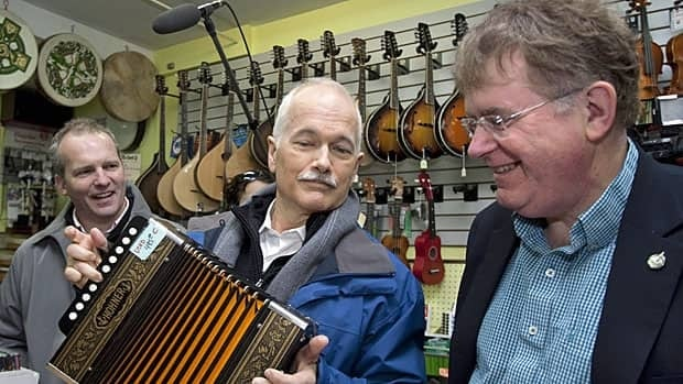 NDP Leader Jack Layton plays the accordion alongside local candidates Ryan Cleary, left, and Jack Harris while visiting a music shop on Saturday, April 16, in St. John's, N.L.