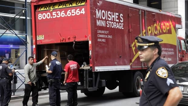 New York City police officers stop a commercial truck at a checkpoint in New York's financial district following confirmation of a 'credible' terror theat.