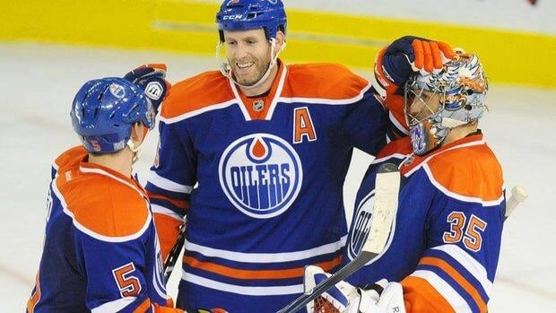 Edmonton Oilers' Ladislav Smid, left, and Ryan Whitney, centre, congratulate goalie Nikolai Khabibulin on his 2-0 shutout win over the New York Rangers on Saturday night.