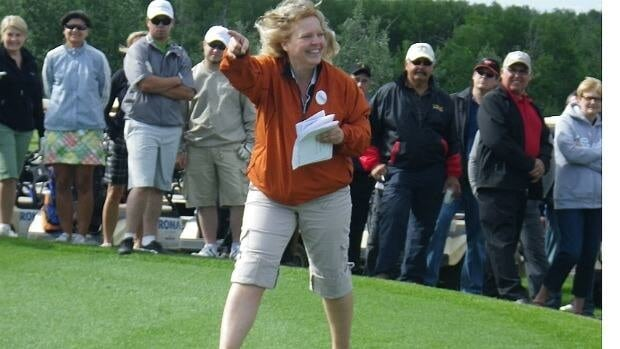 Tournament organizer Jane Palmer introduces Lac La Biche-St. Paul MLA Ray Danyluk at the Cormorant Classic Golf Tournament.