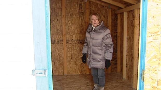 Gilaine Porter stands in the storage shed that held the toys.