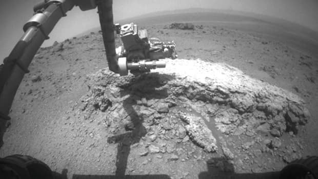 NASA released this image Thursday, showing the Mars Exploration Rover Opportunity using its camera to take a picture showing the rover's arm extended toward a light-toned rock, Tisdale 2.