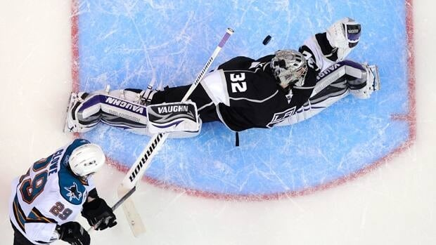 San Jose Sharks right wing Ryane Clowe, left, scores on Los Angeles Kings goalie Jonathan Quick during the second period in Game 3.