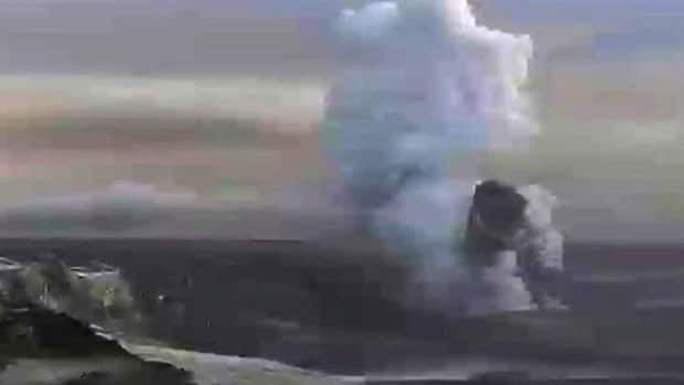 Image from television May 25 shows a plume rising from the Grimsvotn volcano, which erupted and caused ash to blow over Scotland. Scientists this week say another volcano, Hekla, could soon erupt. (RUV Iceland via APTN/Associated Press)