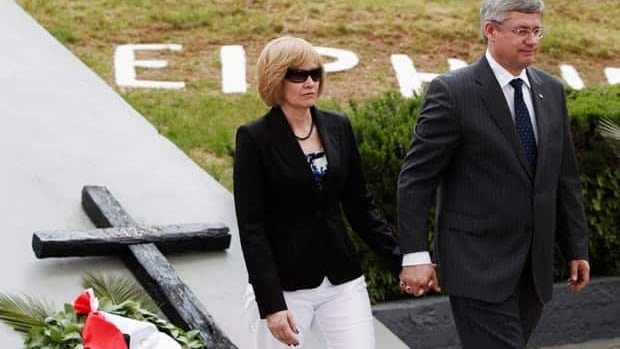 Prime Minister Stephen Harper and his wife Laureen Harper lay a wreath Sunday to honour Greek victims of a Nazi atrocity at the Kalavryta Sacrifice Monument, about 200 kilometres west of Athens.
