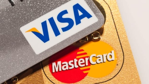 The Competition Bureau suggested regulations be created over retailer surcharges for credit cards. Merchants want a ruling on how much credit card issuers can charge them. (Canadian Press)