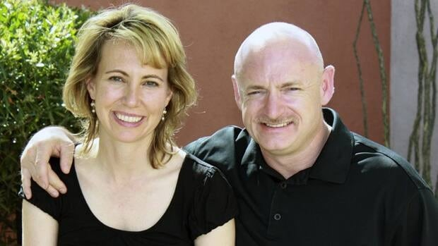 U.S. Congresswoman Gabrielle Giffords and her astronaut husband, Mark Kelly, in a file photo. Doctors said Friday that she is making 'leaps and bounds' in her recovery from being shot in the head.