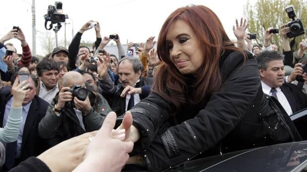 Argentine President Cristina Fernandez de Kirchner greets supporters after casting her vote Sunday in a polling station in Patagonia. Fernandez's anti-poverty programs looked set to handily propel her to a second term.