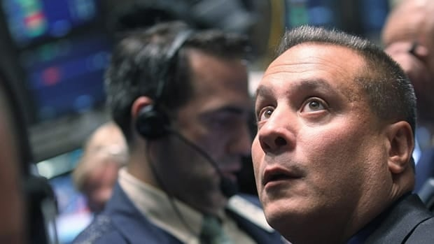 Traders work on the floor of the New York Stock Exchange Friday. The NYSE rebounded from a 500-point drop Thursday on reports of a deal for fiscal reforms in Italy.