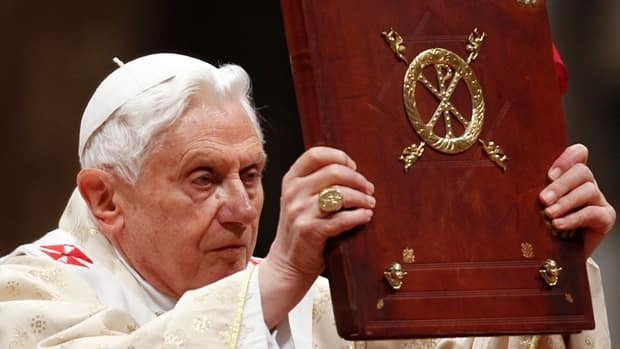 Pope Benedict XVI holds the book of the gospels as he leads the Christmas Mass in Saint Peter's Basilica at the Vatican on Saturday night. Max Rossi/Reuters