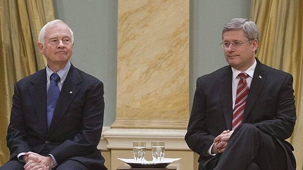 Gov. Gen. David Johnston, left, will swear in Prime Minister Stephen Harper's new cabinet Wednesday morning at Rideau Hall. The pair are pictured during the last cabinet ceremony on Jan. 4, 2011.