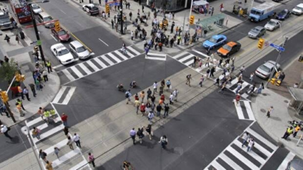 "Toronto's first ""pedestrian scramble"" intersection at Yonge and Dundas Streets, unveiled three years ago, is being targeted in a traffic review."