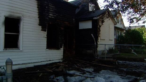 A fire that burned through two homes in Winnipeg's North End caused an estimated $330,000 in damage.