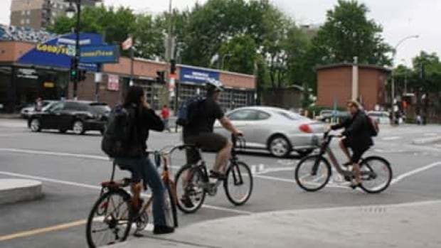 Police stopped cyclists in Montreal Wednesday to warn them that riding with headphones or earbuds is illegal.
