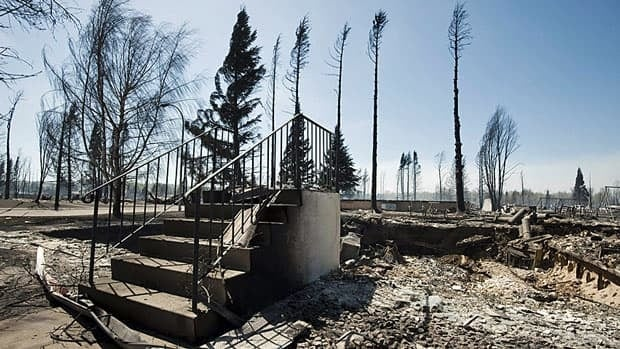 Steps are all that remain of a house in Slave Lake, Alta. May 16, 2011. Experts warn wildfires will pose an increasing threat to Canadian towns.