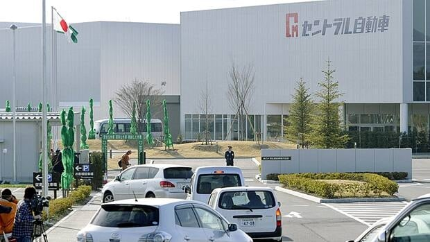 Employees of Central Motor, a subsidiary of Toyota Motor Corp., arrive by car at a factory in Ohira, Miyagi Prefecture, northern Japan on Monday.