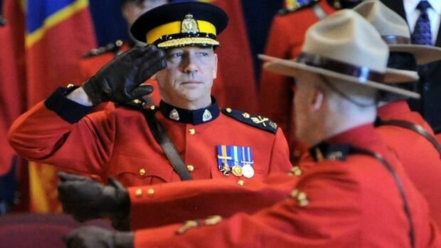 RCMP Commissioner Bob Paulson watches the parade march past as he takes part in a change of command ceremony welcoming him as the 23rd commissioner in Ottawa on Dec. 8, 2011.