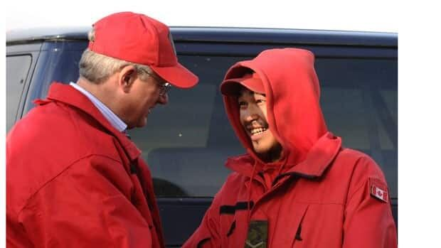 Prime Minister Stephen Harper speaks to a young Canadian Ranger before departing Resolute, Nunavut, on his four-day tour of the North.