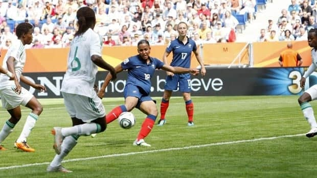 France's Marie-Laure Delie, middle, scores the opening goal of the Women's World Cup on Sunday.
