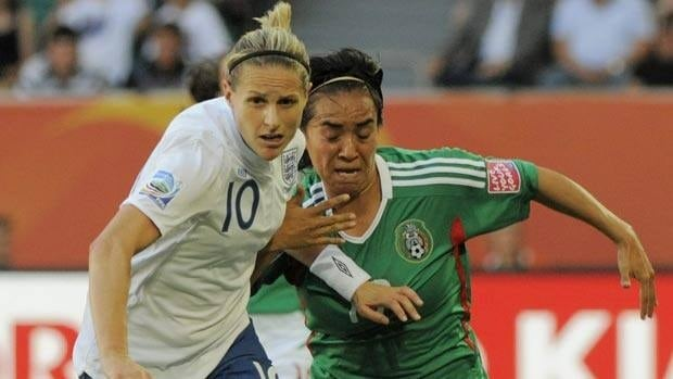 England's Kelly Smith, left, and Mexico's Monica Ocampo challenge for the ball Monday's game.