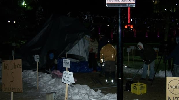 Protesters dismantled their tents at Calgary's Olympic Plaza, leaving only placards by Friday morning.