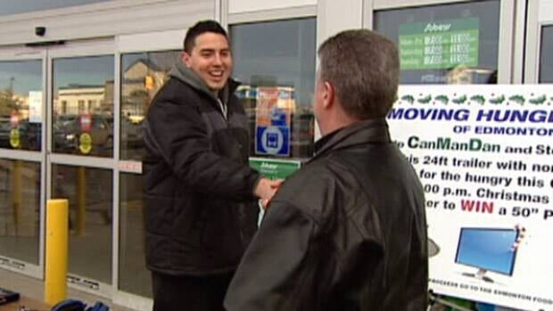 Dan Johnstone greets a man outside a south Edmonton Sobey's store during his fundraising drive last week.