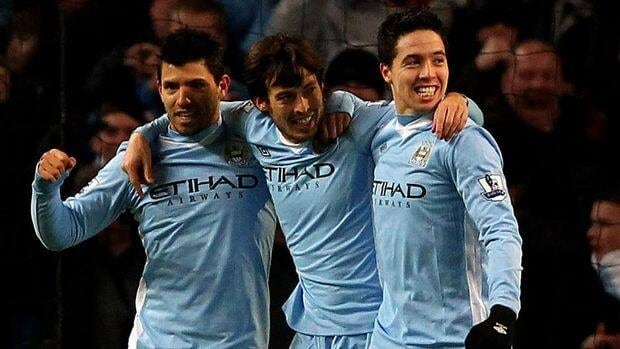David Silva of Manchester City, centre, celebrates scoring the opening goal with teammates Sergio Aguero, left, and Samir Nasri.