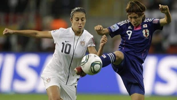 United States' Carli Lloyd, left, and Japan's Nahomi Kawasumi compete for the ball during Sunday's final in Frankfurt, Germany.