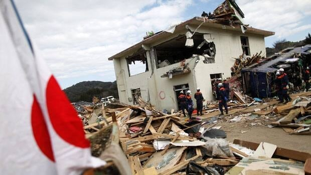 A Japanese flag is seen in the rubble as the search operation continues in Kirikiri, more than three weeks after the area was devastated by a 9.0 magnitude earthquake and tsunami.