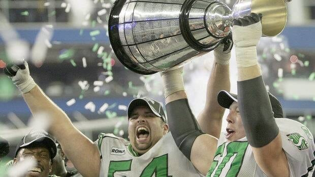 Saskatchewan Roughriders offensive linemen Jeremy O'Day, left, and Gene Makowsky hoist the Grey Cup after beating the Winnipeg Blue Bombers 23-19 to win the 95th CFL Grey Cup in Toronto Nov. 25, 2007.