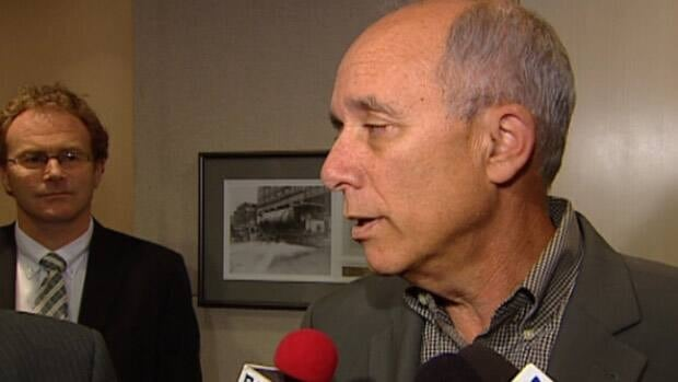 Edmonton Mayor Stephen Mandel speaks to reporters Thursday as City Manager Simon Farbrother looks on.
