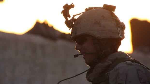 A Canadian soldier prepares to head out on a foot patrol at sunrise from a small Canadian outpost south of the Afghan town of Bazar-e Panjwaii in April 2011. According to a U.S. diplomatic cable released by WikiLeaks, Stephen Harper's minority Conservative government in 2009 was reconsidering its planned 2011 end date for the Afghanistan combat mission.