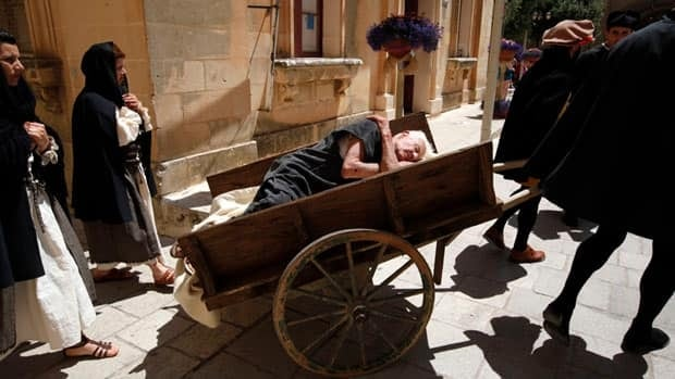 Re-enactors recreate a scene showing a funeral during the Black Death plague during the Medieval Mdina Festival in Mdina, Malta. The plague is estimated to have killed about a third of Europe's population between 1347 to 1351.