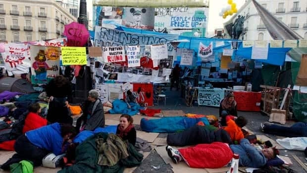 Demonstrators camp out in Madrid's Puerta del Sol on Saturday.