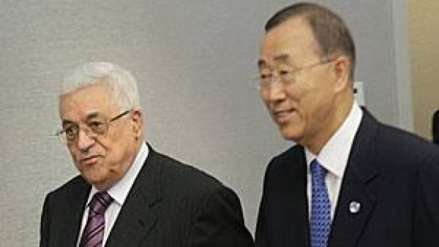 President Mahmoud Abbas, left, enters the room with United Nations Secretary-General Ban Ki-moon on Monday during the 66th session of the General Assembly at UN headquarters in New York.