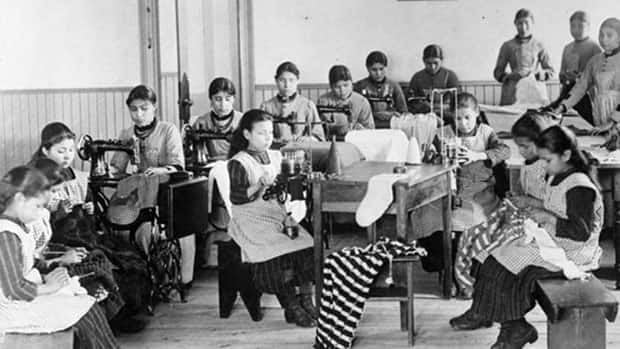 Residential school students are seen in an archival photo of a classroom in Resolution, N.W.T. Community leaders say the government is underestimating the number of former students that will come forward for compensation.