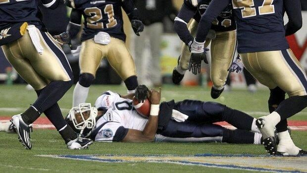 Toronto Argonauts' Steven Jyles lies on the field after taking a hard hit during Friday's game against the Winnipeg Blue Bombers.