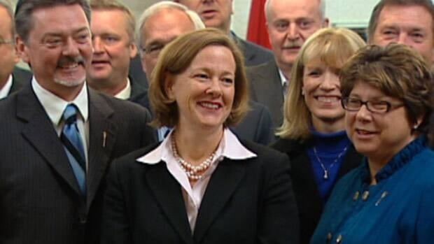 Alberta Premier-designate Alison Redford is flanked by Doug Horner and Mary Anne Jablonski, front right, following a meeting of Tory MLAs at Government House in Edmonton Tuesday. Redford announced that Horner, one of her leadership rivals, will serve as deputy premier in her government.