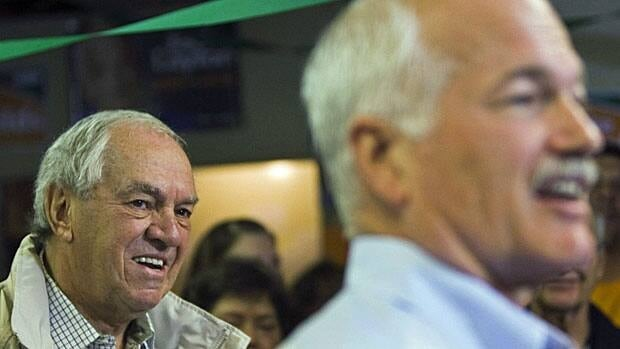 Ed Broadbent, left, listens as NDP Leader Jack Layton, right, speaks during a 2008 campaign stop.