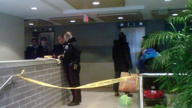 Toronto police cordoned off part of the lobby of a building in Regent Park where a man's body was found Monday morning. Ryan Vella/CBC