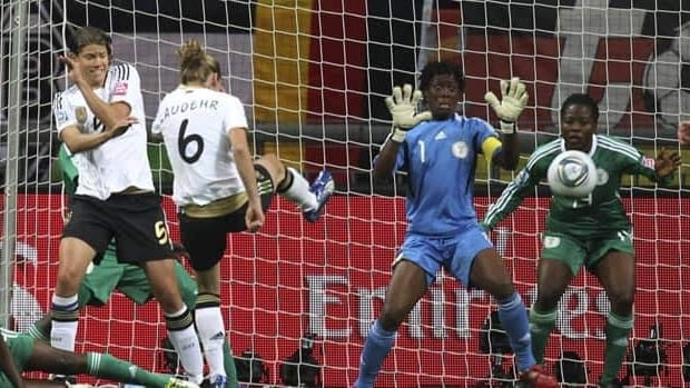 Germany's Simone Laudehr scores on Nigeria goalkeeper Precious Dede in Frankfurt on Thursday.