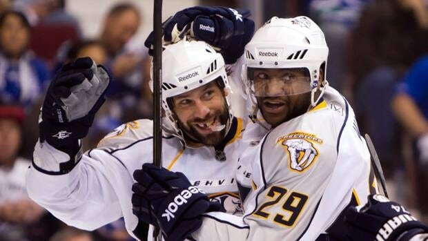 Nashville Predators' David Legwand, left, and Joel Ward celebrate Legwand's goal against the Vancouver Canucks during the second period of Game 5 in Vancouver on Saturday.