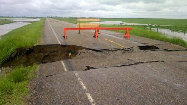 This section of Highway 56 north of Indian Head, Sask., started to collapse Tuesday morning. Adam Hunter/CBC