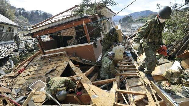 Japan Self-Defence Force members search for missing persons from the March 11 earthquake and tsunami-destroyed town of Onagawa, in northern Japan, on Friday.