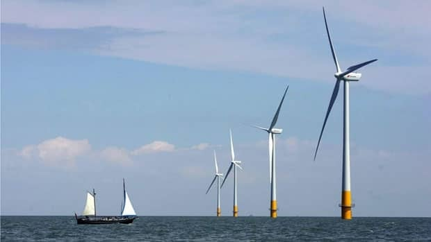 A vessel sails towards a wind farm off the southeastern coast of England.